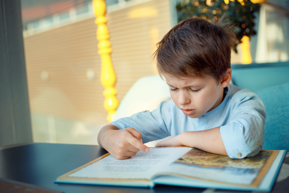 Boy frustrated reading