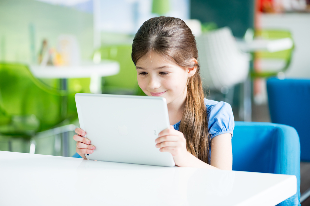Girl using free reading apps for kids